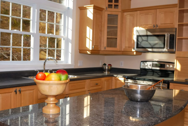 Granite Countertops Dark wood Cabinets