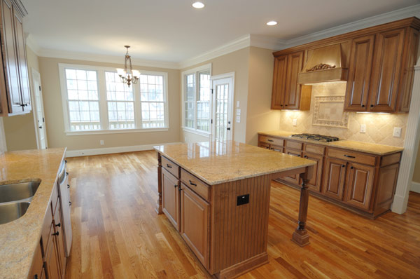 Granite Countertops tan wood Cabinets island